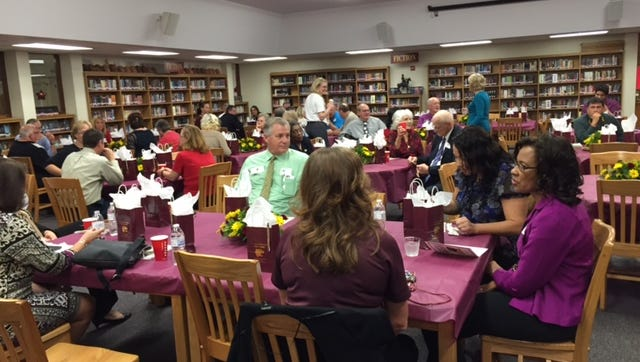 Dignitaries gather in the school's media center prior to ceremonies on Wednesday.