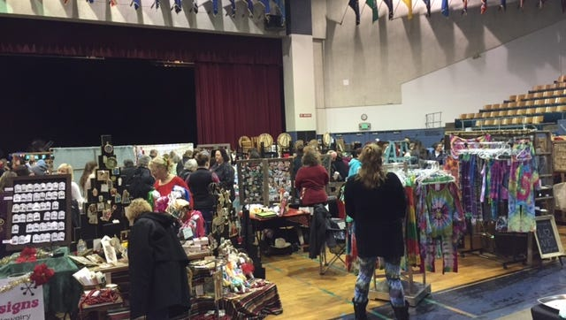 People peruse the different booths at the Salem Etsy Team Holiday Craft Fair on Saturday, Dec. 12 in Salem, Ore.