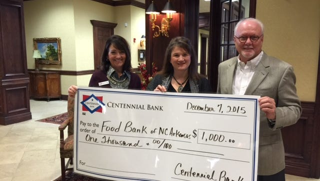 Centennial Bank of Mountain Home awarded a $1,000 Community Involvement Grant to the Food Bank of North Central Arkansas.  This donation will provide 5,000 meals at the Food Bank. Centennial Bank is a continued partner in helping to increase access to nutritious food for children and seniors. Pictured right to left are Philip Young, Mary Jo McLean and Kathryn Hicks.