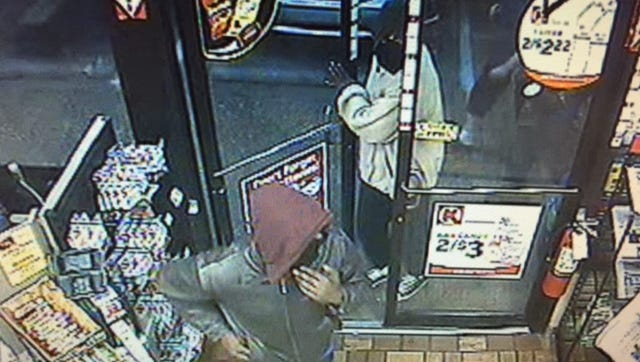 Surveillance video captured images of two men wanted in the robbery of a Circle K store last Wednesday.