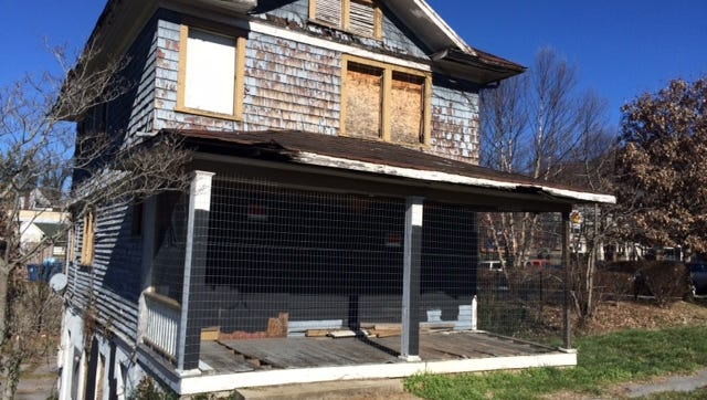 This dilapidated house just off I-240 at Charlotte Street has been vacant, but secured, for years. The owner says they hope to lease the land for a hotel.