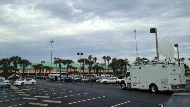 Media vans arrive at the Publix where a winning Powerball ticket worth hundreds of millions was sold.