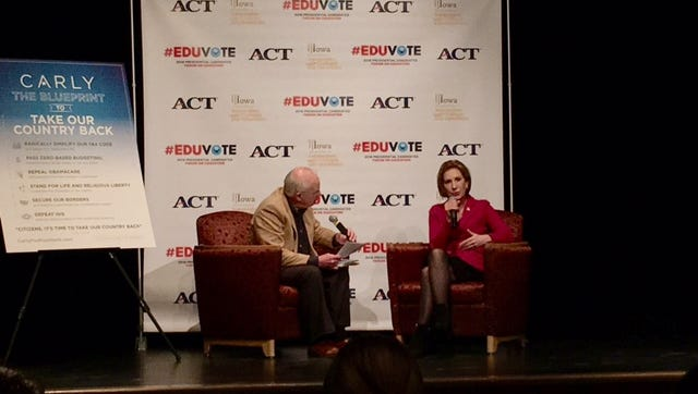 Carly Fiorina (right) talks about education policy in Waverly, Iowa.