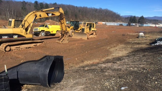 Two sets of apartments, by different developers, are under construction near Thompson Street in Asheville.