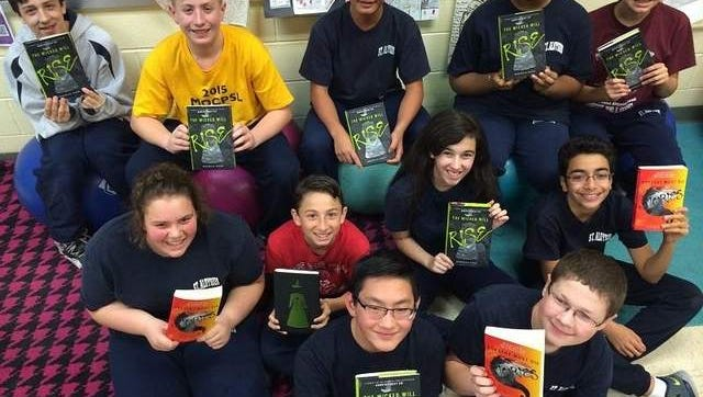 Photo is of students in Mrs. Hoover's class with their books.