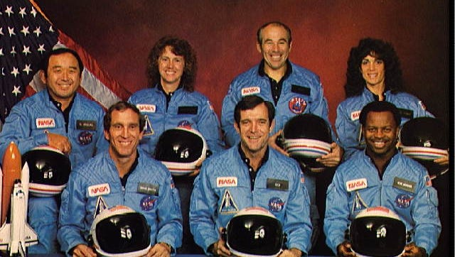 Challenger crewmembers were, back row from left, Mission Specialist Ellison S. Onizuka, Teacher in Space Participant Christa McAuliffe, Payload Specialist Greg Jarvis and Mission Specialist Judith Resnik. Front row from left, Pilot Mike Smith, Commander Dick Scobee, and Mission Specialist Ron McNair.