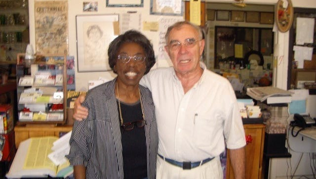 Veronica Shoemaker with Father Robert Browning at Shoemaker's flower shop in 2007.