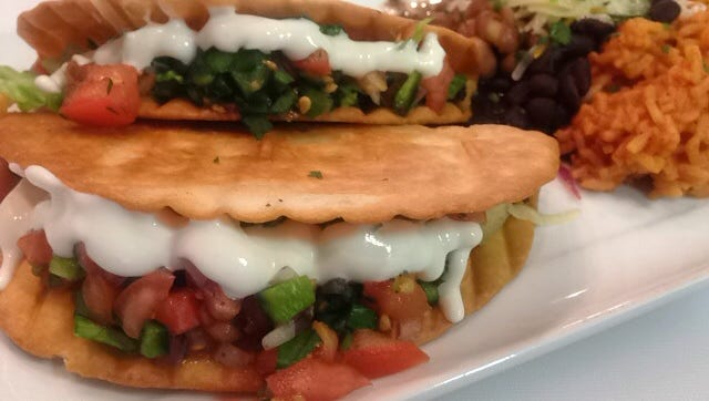 Puffy shell beef tacos with black beans and Spanish rice at Corner Cantina, a Tex-Mex place opening Jan. 28, 2016, in Downtown Indy, where New Orleans on the Avenue used to be.