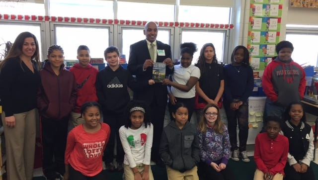 Troy Lewis, author of Gas Money, spoke with fourth graders at Green Grove Elementary School on Monday for Black History Month.