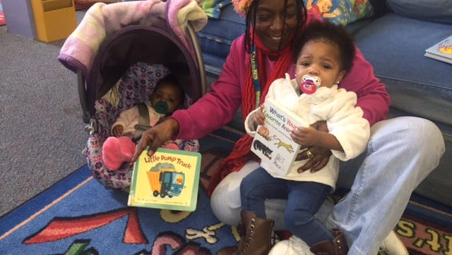 Jazziya Lewis, 1, of Bridgeton, and her baby sister Jazzlyn Lewis, 4 months, enjoy reading time at the Cumberland County Library with their grandmother, Amy Suggs of Fairton. Jazziya enjoys looking at picture books and is getting ready to begin the library's 1000 Books Before Kindergarten program along with her baby sister.