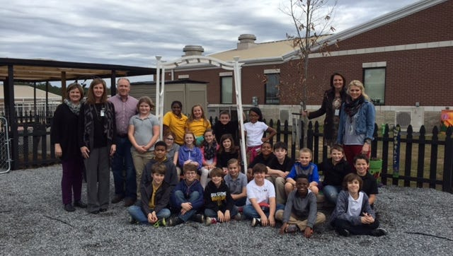 Oak Grove Upper Elementary students and officials received a $5,000 grant for their garden.