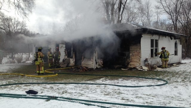 Firefighters work to extinguish a fire at 25 Gardenia St. in Battle Creek. The fire was reported at 12:13 p.m. Thursday.