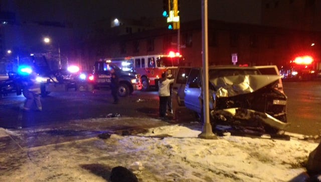 Four people were injured in a crash at Capitol Avenue and Kalamazoo Street in downtown Lansing on Tuesday night.