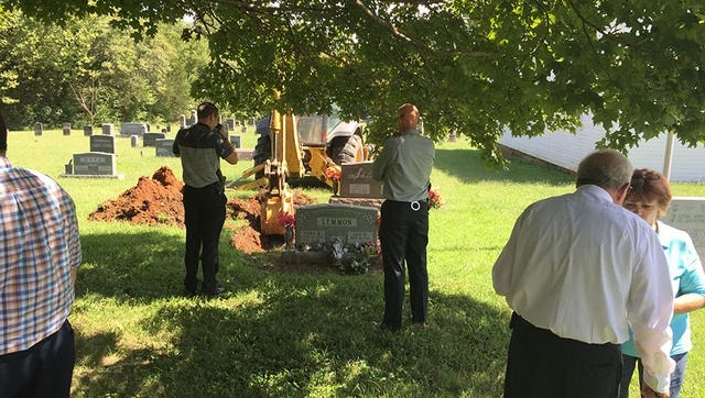 Officials exhume remains from Debra Lemmon's grave at the Hickory Grove Cemetery on Sept. 10.