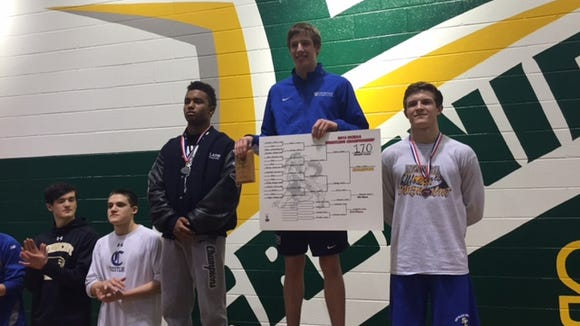 Asheville School senior Conor Fenn won the NCISAA championship at 170 pounds on Saturday in Arden.