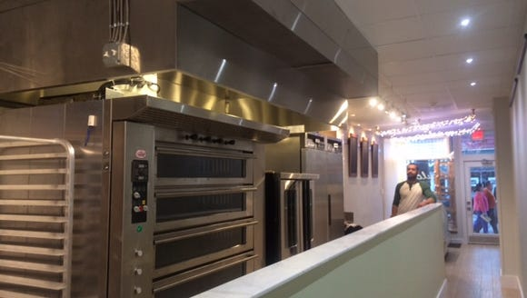 Bakery ovens stand ready for Negron's croissants, cakes,