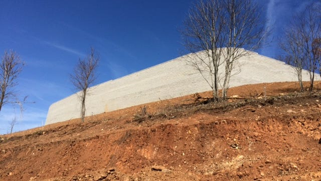 This large retaining wall atop a mountain in Woodfin was built to create a site for a bed & breakfast/events center, part of the Serenity subdivision.