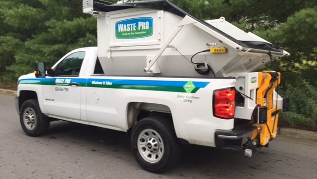 Waste Pro added five heavy-duty pickup tricks like this one to help drivers access narrow, rural roads in Buncombe County.