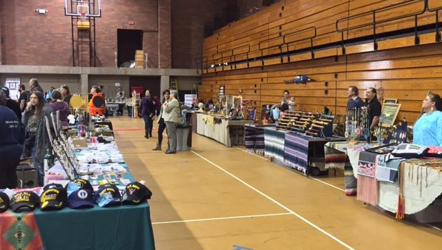 Vendors line the gym at the 14th annual Native American Pow Wow at Willamette University on Saturday.