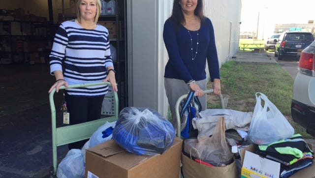 Teachers collecting clothing donations for students in Bossier Parish.