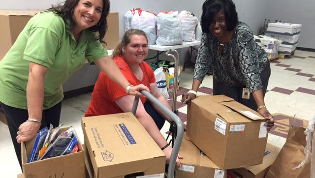 Volunteers pose with donations collected for Bossier Parish students impacted by the flood.