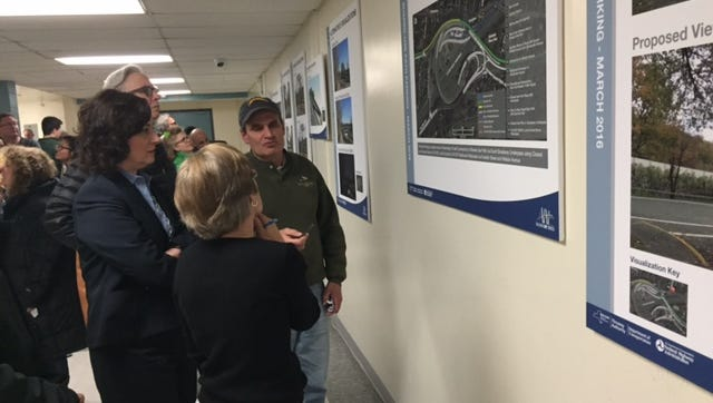 Residents examine one of the posters explaining Alternative F -- the preferred alternative -- after a public hearing at Nyack Middle School on March 16, 2015.