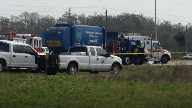 At least one person was killed in a crash involving a garbage truck on SR 82.