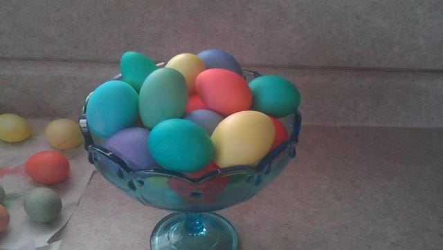 Younger Amish children still enjoy coloring Easter eggs from their own hens.