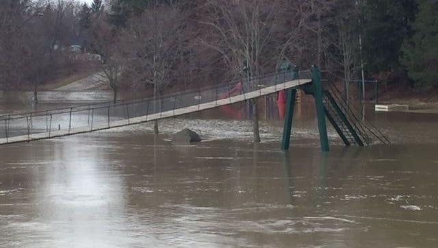 Rains and high water led to flooding Friday, March 25, 2016, around the Croswell Swinging Bridge over the Black River.