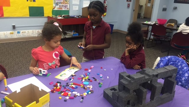 (From left) Leylani Casper of Upper Deerfield and Amirah and Amorie Murphy of Bridgeton construct a new world at Cumberland County Library.