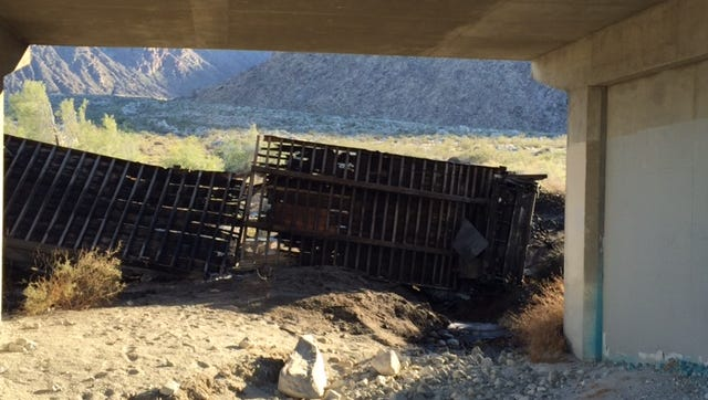 A big rig caught fire and tumbled three stories off a bridge on 111, authorities say.