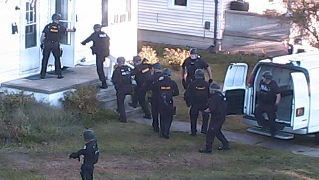 Galion Police Department authorities prepare to raid a home on South Market Street in Galion last year.