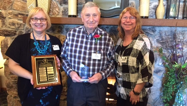 The 2016 Felician Award for Excellence in Volunteer Service at Felician Village was presented to Harold Kimmel at a ceremony held on April 12. The award was presented by volunteer coordinator Kim Loose, left, and vice president of health services Kay Kopenski, right.