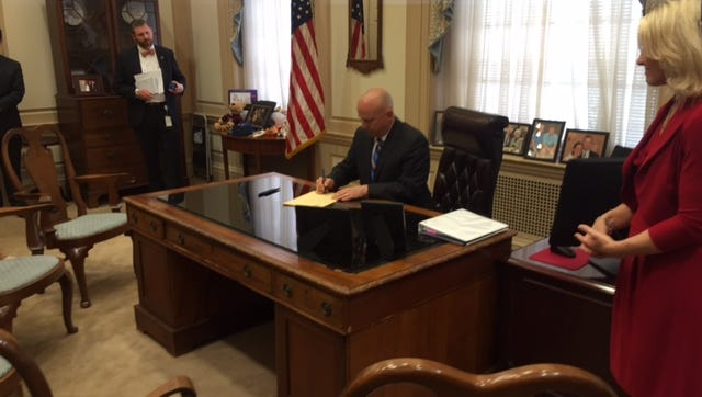 Gov. Jack Markell signs a bill creating the Drug Overdose Fatality Review Commission Thursday in Dover. The panel will be charged with investigating and reviewing all overdose deaths involving prescribed opiates, fentanyl or heroin.