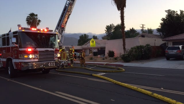 Firefighters work to contain a fire that broke out in a duplex in the 33-300 block of Cathedral Canyon Drive Tuesday evening.