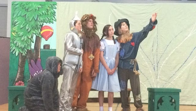 "Pictured here is part of the cast of ""Dorthy in Wonderland,"" which includes Wayne Compton as Toto, Jack Marks as the Tin Man, Connor Bowes as the Lion, Claire Bowler as Dorothy, and Augie Kennedy as the Scarecrow. The St. Francis de Sales Catholic School production happens May 5, 2016."