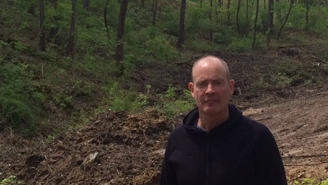 Jim Langland stands in part of Memorial Park damaged by construction of a detention basin.