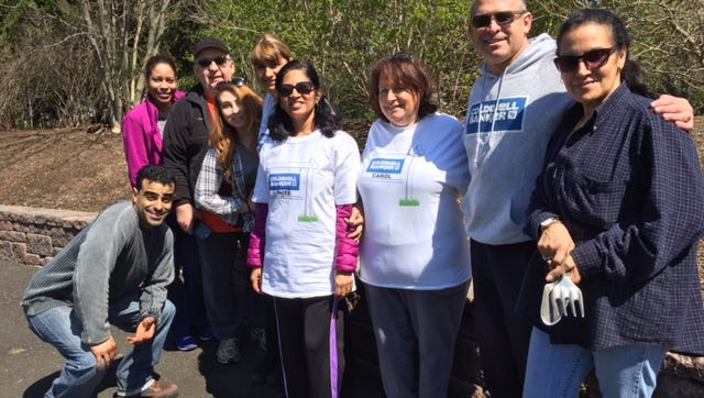 Volunteers from Coldwell Banker Residential Brokerage in South Brunswick planted a sensory garden at Veteran's Park in Kendall Park for Coldwell Banker Cares Day. Pictured are (left to right) Robert Rodriguez, Nerissa Bridges-Rodriguez, Steve Zalewski, Shelly Honey Cohen, Sabrina Kober, Anita Britto, Carol Cohen, Lou Redbord and Yvonne Bartolotta.