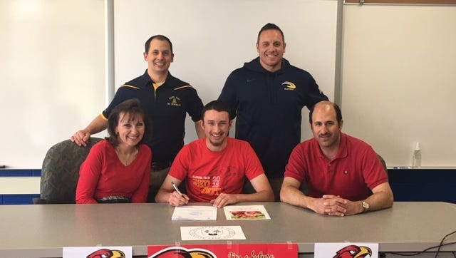Algonac senior Joe Hindy signs with Illinois Institute of Technology baseball on Monday at Algonac High School.