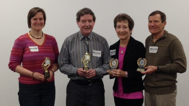 """""""Table Topics"""" winners (from left) Juliet Kosarzycki, second place, and Dave Eiden, first place; and International Speech winners (from left), Connie Willems, first place, and Roy Pirrung, second place."""