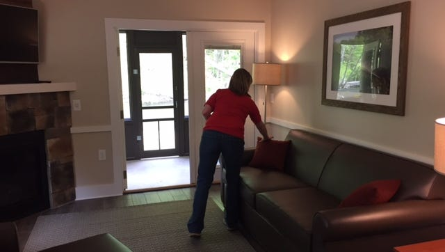 Bethany McCorkle, an Ohio Department of Natural Resources spokeswoman, shows off a newly renovated cabin at Mohican State Park Campground on Friday.