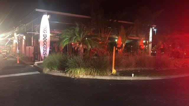 A Palm Bay Police officer is crediting spotting a fire and saving a popular eatery