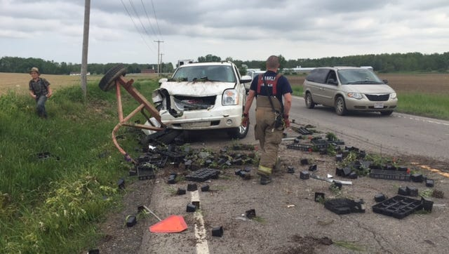 An SUV traveling south on Ohio 13 Thursday morning north of Ganges Five Points Road rear-ended a farm tractor pulling a wagon carrying flowers and plants, according to the Ohio Highway Patrol.