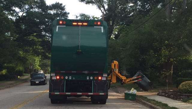 The city of Greenville has begun using trucks with mechanical arms to pick up trash.