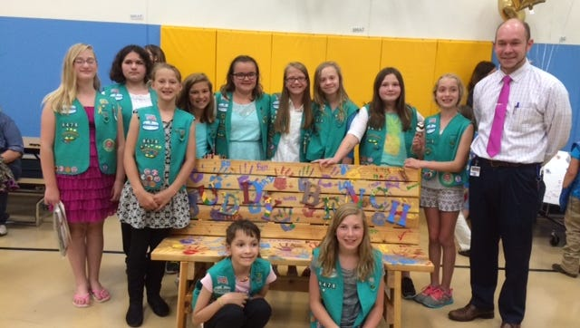 The 10-member Girl Scout Troop 8478 of Manitowoc was recently awarded the Girl Scout Bronze Award for building a Buddy Bench for Franklin Elementary School. Troop members are, standing, from left: Shantel Lucia, Savannah Boldt, Laura Heim, Kendra Wech, Jazmyne Bauer, Taliah VanSluys, Brianna Davis, Sakkara Ordiway and Evangeline Zak with Franklin principal Nate Brunnbauer. Kneeling is Cristina Steen and Isabella Meyer. Troop advisers, not pictured, are Jodi Heim, Tammy Lucia and Amy Bauer.
