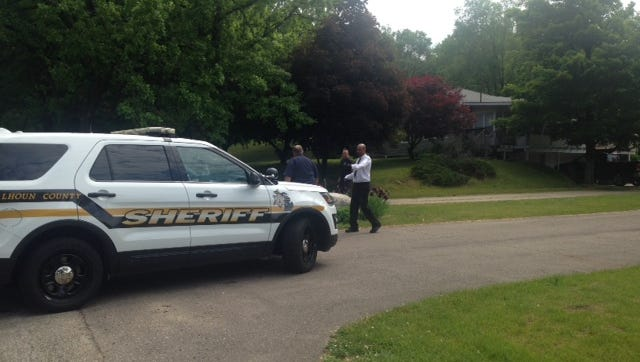 Police were called to an Emmett Township home where two people were found shot to death.