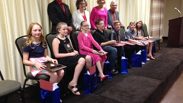 The Southport Kiwanis Club recently handed out Kiwanis K-Dette awards. Recipients include, front row from left: Holy Family Catholic School students Leah DeFilippo and Gracie Ringer; Elmira Christian Academy student Josephine Burleigh; Coburn Elementary School students Seth Waddell and Shane Heifferon; and Broadway Elementary School students Jonathan Conklin and Kaitlynn Place. Pictured in the back row are Southport board member Joe Roman, Sharon Moore who is representing Senator Tom O'Mara, and program co-chairs Gail Veruto and Rudy Veruto.