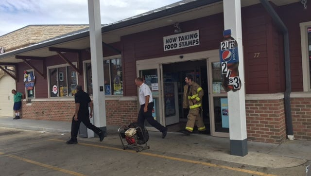 Mansfield firefighters investigate a fire at the Shell station at 77 S. Diamond St. Wednesday. Juveniles may have set a bag of chips on fire inside the store.
