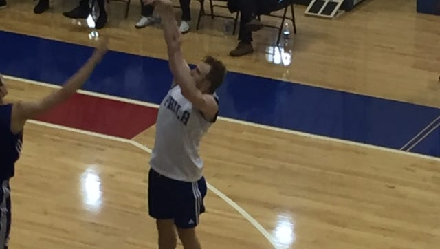 Former Sanford School and Syracuse star Trevor Cooney takes a shot during a workout Wednesday with the 76ers.