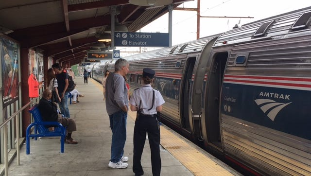 Passengers wait to board Amtrak trains at the Wilmington train station.